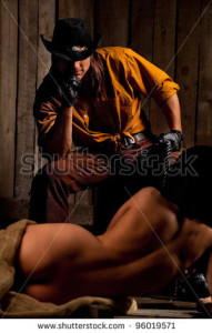 stock-photo-cowboy-with-naked-bondwoman-against-wooden-background-96019571
